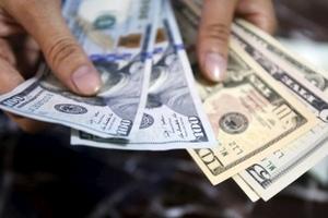 Tỷ giá USD trong nước và quốc tế biến động trái chiều