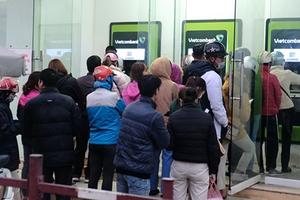 NHNN: Không để ảnh hưởng đến việc thanh toán và rút tiền chi tiêu của người dân