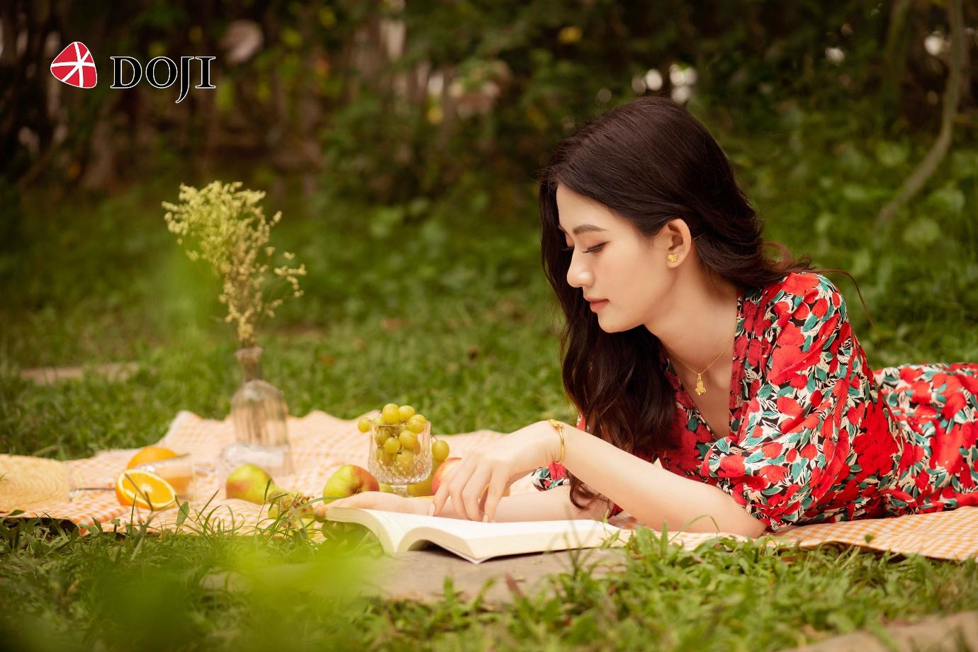 A person reading a book  Description automatically generated