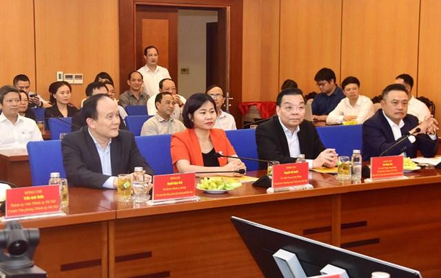 Các đồng chí lãnh đạo Bộ Tài chính, Kiểm toán Nhà nước và thành phố Hà Nội dự hội nghị.