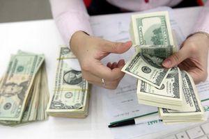 Tỷ giá có xu hướng giảm ở các thị trường sau động thái hạ giá mua vào USD của NHNN